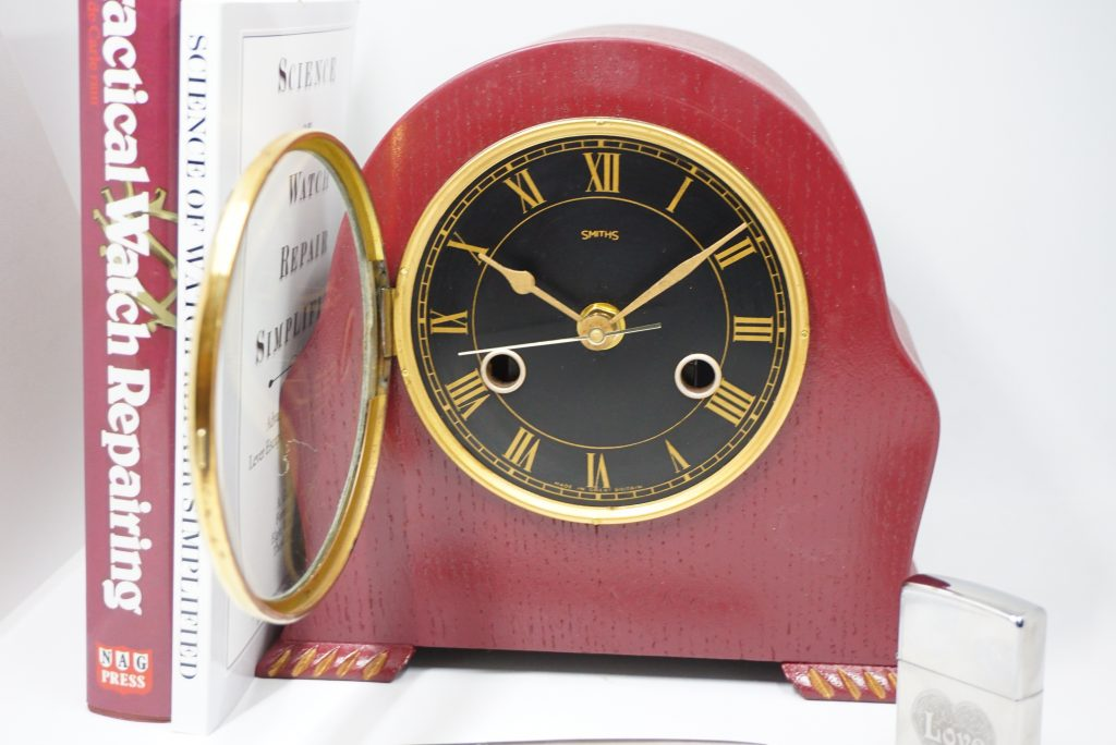 Another example of an upcycled clock. This one is a Smiths 8 day clock converted to battery movement and painted in purple with gold accents to match the black and gold dial