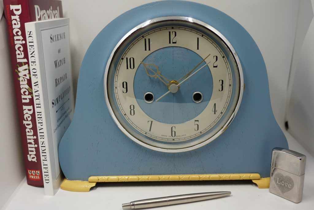 Example of an art deco mantle clock upcycled by ClocksUpcycled. Sky blue case with cream accent. Clock makeovers available now